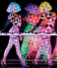 The rainbow-colored line-up at the Crazy Horse Cabaret Show entertains during your dinner.