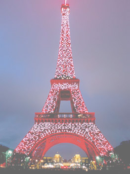 The Eiffel Tower decked out in red lights for seasonal celebrations.